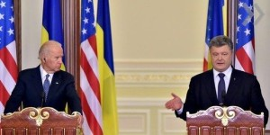 Ukrainian President Petro Poroshenko gestures beside U.S. Vice President Joe Biden as he delivers a statement on the results of their talks in Kiev