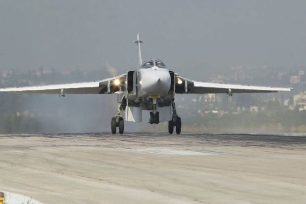 Russia's Defence Ministry handout photo shows Sukhoi Su-24 fighter jet lands at Hmeymim air base near Latakia in Syria