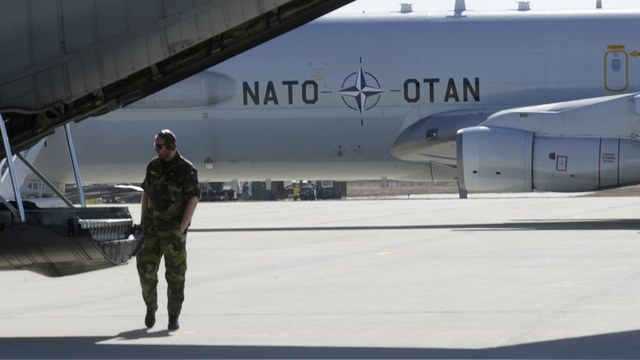 A military specialist inspects a Sweden's Air Force cargo plane during a joint NATO military exercise in Siauliai