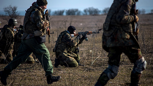 Volunteers of the Azov Battalion excercise firing practice