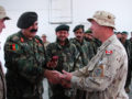 KANDAHAR, Afghanistan--Warrant Officer Wade Osmond, chief instructor for the Basic Engineer Course and member of the Candaidan Operational Mentoring Liason Team (OMLT) accepts his Canadian Forces Decoration for 22 years of service in the Canadian Army at a graduation ceremony for the Basic Engineers course at Camp Hero on February 5, 2009. Fifteen graduates completed the four-week course that taught fundamentals in mine detection and demolition, field defense, and basic carpentry. ISAF photo by U.S. Navy Petty Officer 2nd Class Aramis X. Ramirez (RELEASED)