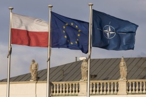 Polish, European Union and NATO flags wave at Poland's Presidential Palace in Warsaw
