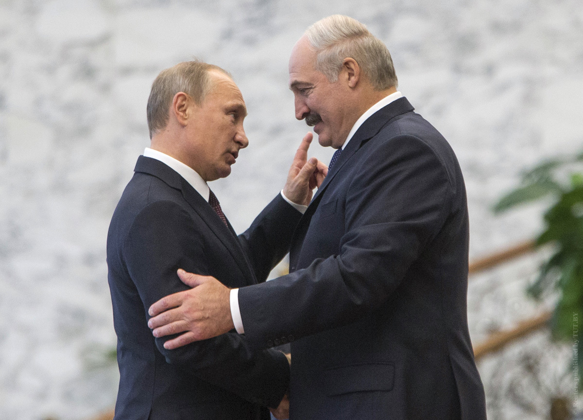 Belarus' President Lukashenko greets his Russian counterpart Putin at a meeting during a CIS summit in Minsk