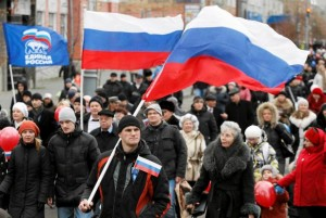 People take part in a demonstration on the National Unity Day in Russia's Siberian city of Krasnoyarsk
