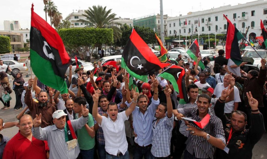 People celebrate in the streets, amid reports that Moammar Gadhafi's death by anti-Gadhafi forces overwhelmed his hometown of Sirte, in Tripoli, Libya, on October 20, 2011. Even before confirmation of ousted Libyan leader Moammar Gadhafi's death came from the nation's interim government Thursday, Libyans erupted in jubilation after early reports said he had been captured or killed. (Erhan Sevenler/AA/Abaca Press/MCT)