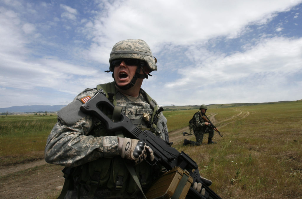 "A U.S. military instructor (L) leads during a NATO exercise named ""Cooperative Lancer 09"" at Vaziani military base outside Tbilisi May 25, 2009. REUTERS/David Mdzinarishvili (GEORGIA POLITICS MILITARY IMAGES OF THE DAY) - RTXN9GJ"