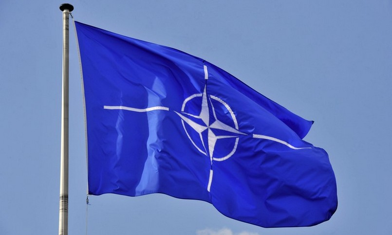 A picture taken on March 2, 2014 shows the NATO flag in the wind at the NATO headquarters in Brussels. AFP PHOTO / GEORGES GOBET