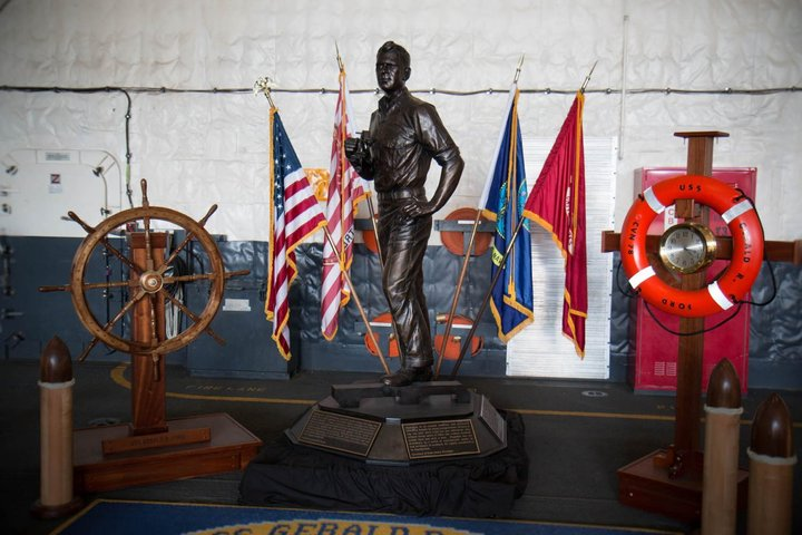 a-statue-of-former-president-gerald-r-ford--the-carriers-namesake--stands-in-the-hangar-bay-ford-served-as-a-navigation-officer-on-the-uss-monterey-during-world-war-ii-his-shipmat