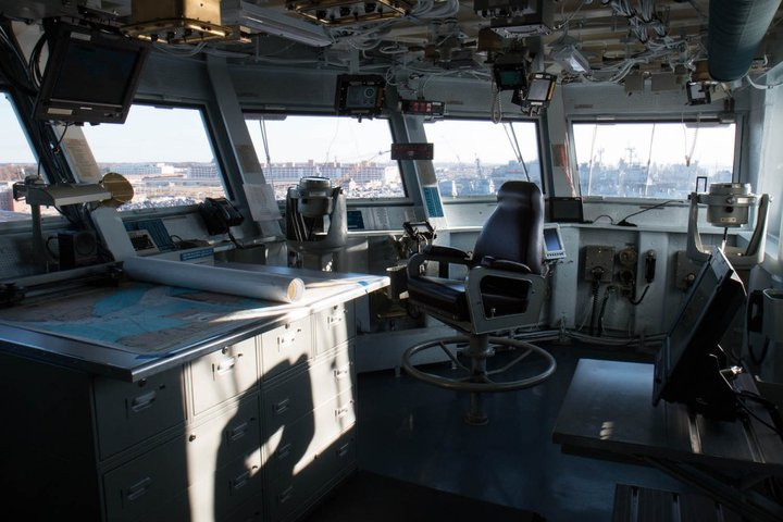 the-navigation-officer-sits-next-to-the-chart-table-the-ship-is-navigated-digitally-and-with-the-paper-charts-jones-said