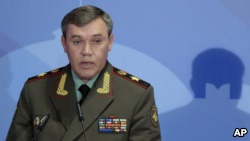 In this Thursday, May 23, 2013 file photo Gen. Valery Gerasimov, the chief of the Russian military's General Staff, speaks during a security conference in Moscow, Russia. The European Union on Tuesday released the names of 15 new targets of sanctions because of their roles in the Ukraine crisis. The list includes Gen. Valery Gerasimov, chief of the Russian General Staff and first deputy defense minister, and Lt. Gen. Igor Sergun, identified as head of GRU, the Russian military intelligence agency.  (AP Photo/Mikhail Metzel, file)
